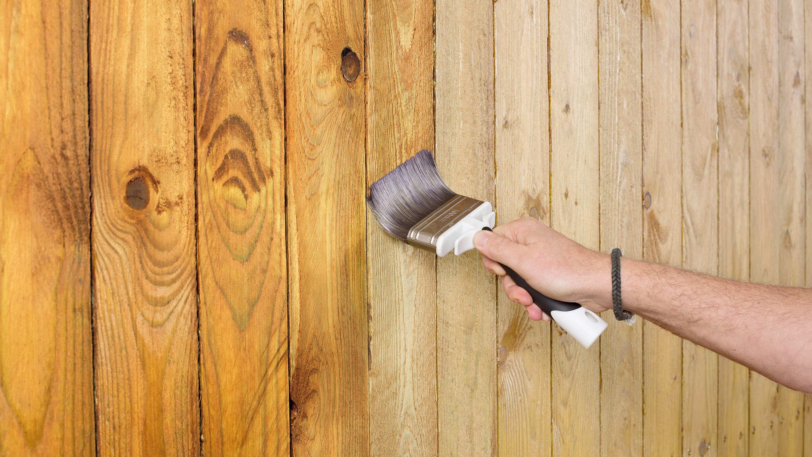 Varnishing a wooden fence